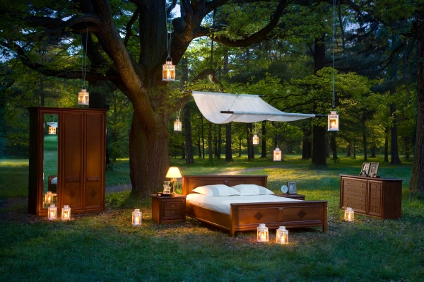 bed in forest - concept of good sleep